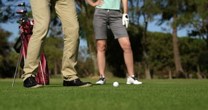 Golfers playing golf. At golf course stock footage