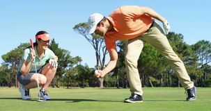 Golfers playing golf. At golf course stock video