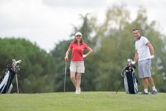 Golfers posing and smiling. Golf Royalty Free Stock Photos