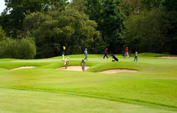 Golfers at practice Stock Photo