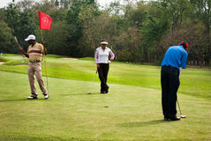 Golfers at practice Royalty Free Stock Photo