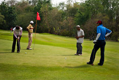 Golfers at practice Stock Images