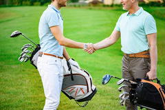 Golfers shake hands with each other Royalty Free Stock Photo
