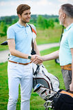 Golfers shake hands with each other Stock Photography