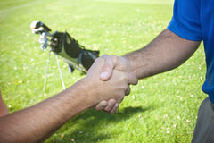 Golfers Shaking Hands Royalty Free Stock Photography