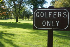 Golfers Only Sign with Grass and Trees Royalty Free Stock Photography