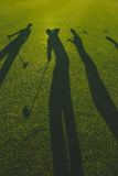 Golfers silhouette on grass Royalty Free Stock Photography
