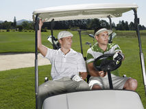 Golfers Sitting In Golf Cart Royalty Free Stock Images