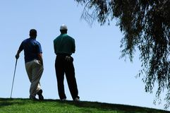 Golfers Wait For Turn To Putt. Golfers Stand At Top of Elevated Green on #7 At Tijeras Creek Stock Photography
