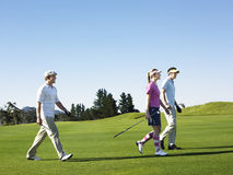 Golfers Walking On Golf Course Royalty Free Stock Photos