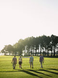 Golfers Walking On Golf Course Royalty Free Stock Images