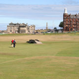 Golfers walking St Andrews. Golfers walking back to Club House, St Andrews stock photos