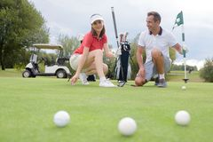 Free Golfers With Three Balls Stock Photography - 120760912