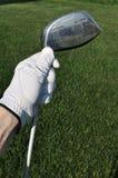 Golfeur retenant un gestionnaire en métal Photos stock
