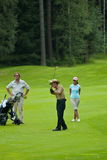 Golfeurs de groupe sur le feeld de golf Photo stock