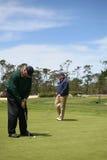 golfing πρεσβύτεροι Στοκ Εικόνες