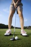 golfing взрослой женщины Стоковое Изображение