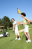 golfing милые женщины Стоковое фото RF