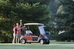 golfing пар горизонтальный Стоковая Фотография