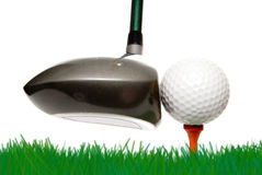 Golfing. A driver just before it hits a golf ball Royalty Free Stock Image