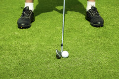Golfing. Ball on the green background Stock Photography