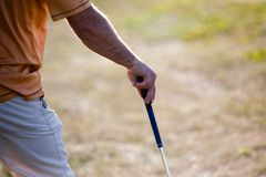 Golfing. Golfer waiting for his turn, focus on hand Stock Images
