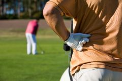 Golfing. Golfers playing golf on beautiful sunny day Royalty Free Stock Photos