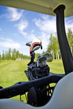 Golfing. Golfbag in buggy, selective focus on clubs Royalty Free Stock Photography