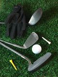 Golfing. Equipment on artficial grass outdoors stock photo