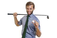 Golfing. Businessman with golf club and ball isolated Stock Photo