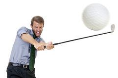 Golfing. Businessman with golf club and ball isolated Stock Image