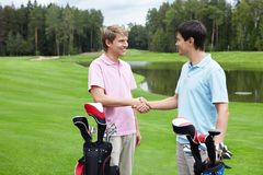 Golfing. Players shake hands on the golf course Stock Photos
