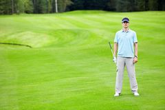 Golfing. A young man on the golf course Royalty Free Stock Photo