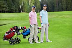 Golfing. Players on the golf course Royalty Free Stock Photo