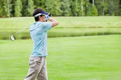 Golfing. Playing a man on the golf course Stock Photo