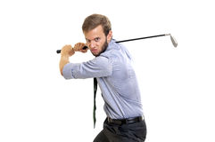 Golfing. Menacing businessman with golf club isolated Royalty Free Stock Image