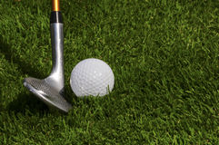 Golfing. Pitching wedge and ball trying to get the ball on the green Stock Images
