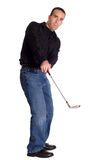 Golfing. Full body view of a young employee golfing, isolated against a white background Stock Photography