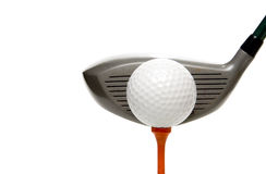 Golfing. A driver just before it hits a golf ball Stock Photos