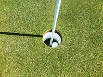 Golfing Accomplishment. The goal of golfing, in the hole stock photography