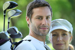 Golfing couple. Head and shoulders of golfing couple Stock Photos
