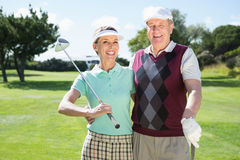 Golfing couple smiling at camera Stock Images
