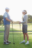 Golfing couple standing and talking Stock Photos