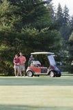 Golfing Couple - Vertical Royalty Free Stock Photos