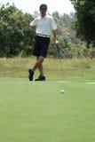 Golfing dell'uomo Fotografie Stock Libere da Diritti