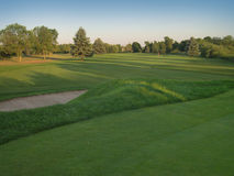Golfing di tramonto Immagine Stock