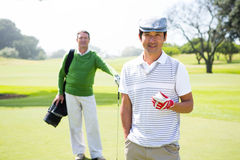 Golfing friends smiling at camera Stock Images