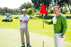 Golfing friends smiling at camera Stock Photos