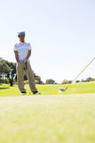 Golfing friends teeing off Royalty Free Stock Image