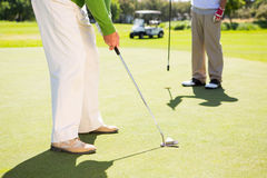 Golfing friends teeing off Stock Images
